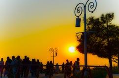 Sunset. A sad sunset while people are enjoying Royalty Free Stock Photo
