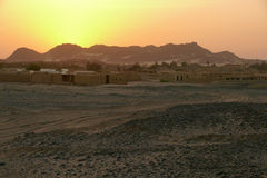 Sunset in the Sahara Desert. City in the desert. Stock Photo