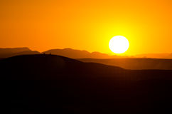 Sunset on Sahara desert Stock Image