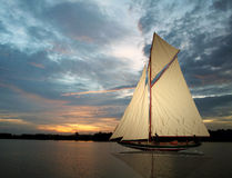 Sunset Sail. Sailboat in the water at sunset Royalty Free Stock Images