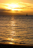 Sunset Sail. A sailboat in front of the setting sun. Taken on Maui's Kaanapali Beach Royalty Free Stock Photo