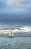 Sunset sail. Sailboat on the water of Elliot Bay during the sunset Royalty Free Stock Photo