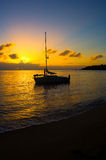 Sunset and sailboat Stock Images