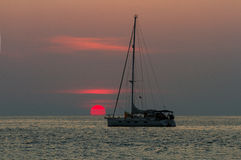 Sunset and sailboat. Sunset in Nai Harn beach and sailboat silhouette. Phuket, Thailand Stock Photo