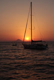 Sunset from sailboat near the volcano Royalty Free Stock Image