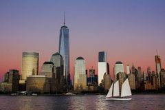 Sunset with sailboat and skyline of Manhattan royalty free stock photo