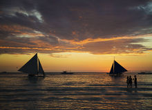 Sunset and sailing boats on tropical white beach in boracay phil Royalty Free Stock Photos
