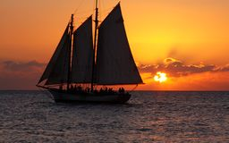 Sunset Sailing Party 2. A sailboat passes through the sunset line in Key West Stock Photography