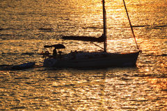 Sunset sailing Stock Photos