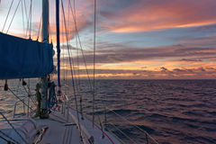 Sunset on a sailing yacht, Pacific Ocean Stock Images