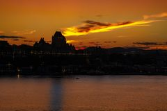 Sunset and the Chateau Frontenac Quebec City. Sunset on the Saint Lawrence seaway and the Chateau Frontenac in Quebec City as a background seen from the Levis stock photos