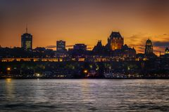 Sunset and the Chateau Frontenac Quebec City. Sunset on the Saint Lawrence seaway and the Chateau Frontenac in Quebec City as a background seen from the Levis royalty free stock photography