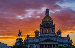 Sunset of Saint-Petersburg. Sunset of Saint Peterburg with Saint Isaac Cathedral and the Monument to Emperor Nicholas I, Russia Royalty Free Stock Image