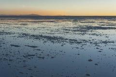 Sunset in the Salar de Uyuni near Colchani. It is the largest salt flat in the World UNESCO World Heritage Site - Bolivia stock photos