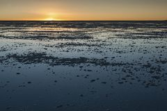 Sunset in the Salar de Uyuni near Colchani. It is the largest salt flat in the World UNESCO World Heritage Site - Bolivia royalty free stock photo