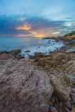 Sunset in  Salou - Spain. Sea Landscape from the rocks. At the Blue hour in Salou, Province of Tarragona , Spain Stock Photos