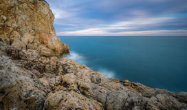 Sunset in  Salou - Spain. Sea Landscape from the rocks. At the Blue hour in Salou, Province of Tarragona , Spain Royalty Free Stock Image