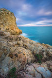 Sunset in  Salou - Spain. Sea Landscape from the rocks. At the Blue hour in Salou, Province of Tarragona , Spain Stock Images