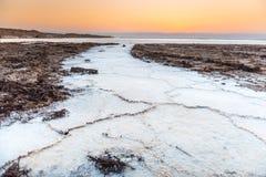 Sunset on salt crystals in the Dead Sea, Jordan Stock Photo