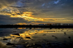 Sunset at salt farm in Thailand Stock Photography