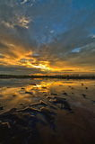 Sunset at salt farm in Thailand Royalty Free Stock Image