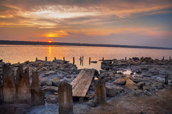 Sunset on the salt lake, estuary. Royalty Free Stock Image