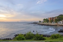 Sunset at Salvador city. Sunset in Salvador overlooking the Bay of All Saints seen from Farol da Barra Stock Image