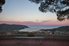 After sunset, San Piero village, Elba island. Sunset on Marina di Campo bay from the hilltop village of San Piero. Elba island, Tuscan archipelago, Italy Royalty Free Stock Image
