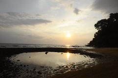 Sunset on sand beach in Tioman island in Malaysia Royalty Free Stock Image