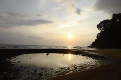 Sunset on sand beach in Tioman island in Malaysia. Sea sunset and boat on sand beach in Tioman island in Malaysia Royalty Free Stock Image