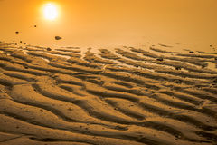 Sunset on sand in sea beach, Thailand Stock Photography