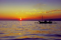 Sunset sand the sea. People in a boat floating on the sea at sunset Stock Photo