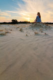 Sunset sand woman Royalty Free Stock Photo