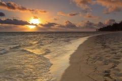 Sunset on the sandy beach Stock Image