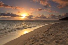 Sunset on the sandy beach Stock Photo