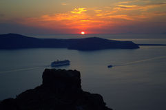 Santorini sunset sailing cruise ship  Royalty Free Stock Photos
