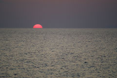 Sunset in Sardinia. A beautiful red sun in the Mediterranean Sea Stock Photo