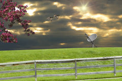 Sunset Satellite Dish. A spring scene with a dish on a hill and crab apple tree in the foreground. Ducks and sunset are in the background Stock Images