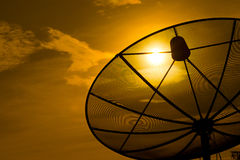 Sunset and satellite dish. Satellite dish on sunset silhouette Stock Photo
