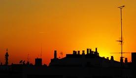Sunset satellite dishes Stock Photography