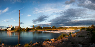Sunset on the Sava river. Across the river a garbage disposal complex Royalty Free Stock Image