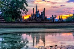 Sunset scence of Wat Mahathat temple in the Sukhothai Historical. Park contains the ruins of old Sukhothai, Thailand, UNESCO world Heritage Site stock image