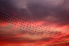 Sunset scene with electric cables and red clouds Royalty Free Stock Images