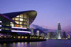 SUNSET SCENE OF HONG KONG. Convention and Exhibition Centre and cityscape Royalty Free Stock Photos