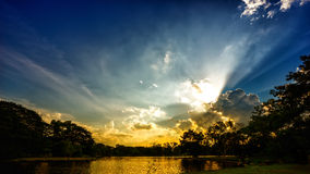 Sunset scene on lake with beautiful clouds and sky Stock Photo