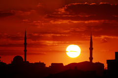 Sunset scene with mosque and minarets Royalty Free Stock Photography
