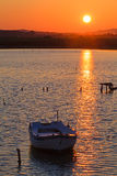 Sunset scene with nets and boat Stock Images
