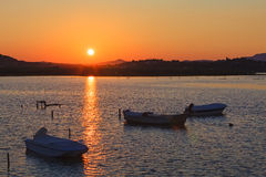 Sunset scene with nets and boat Royalty Free Stock Image