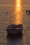 Sunset scene with nets and boat Stock Photo