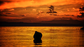 Sunset scene. An old buoy pictured in the sunset Royalty Free Stock Image